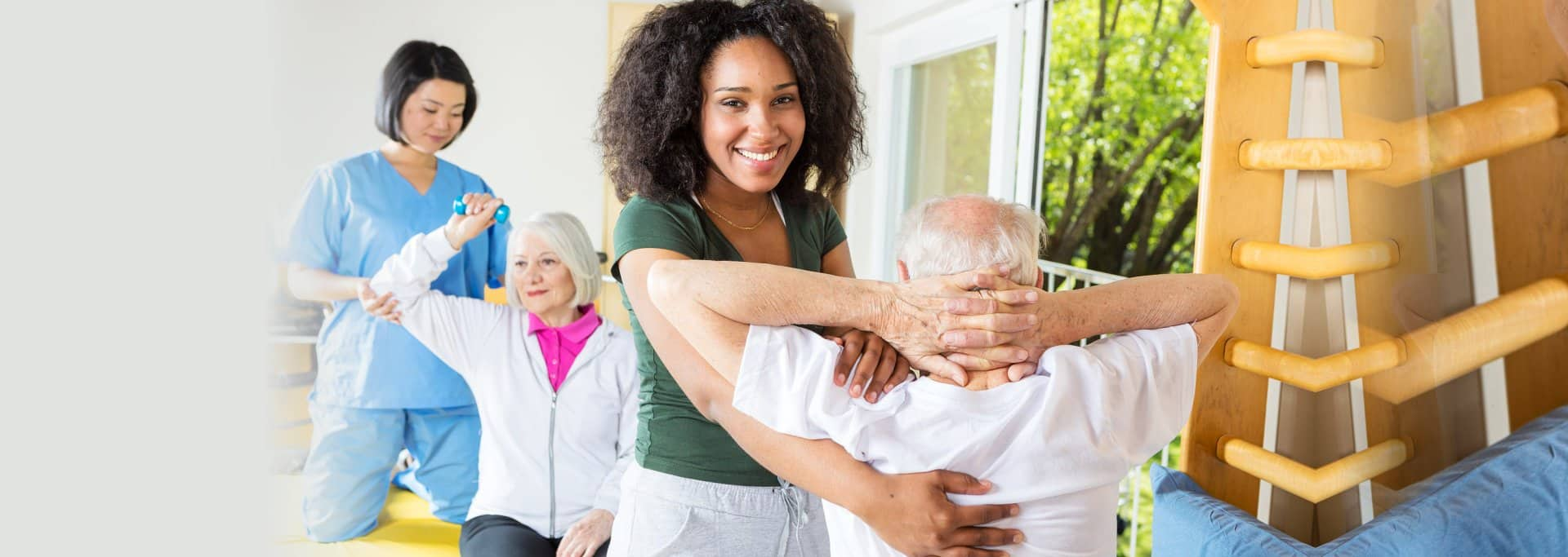 elderly people exercising and caregiver assisting them