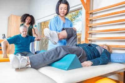caregiver helping elderly patients